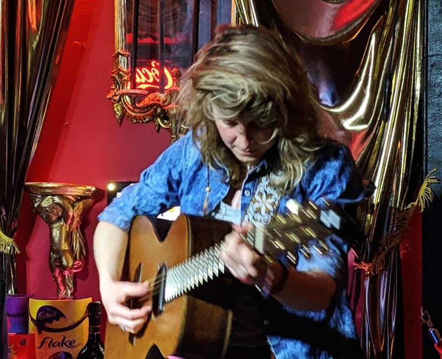 Faye Polden playing guitar