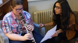 Music Leader with Young Participant, playing clarinet