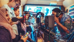Young people stand together in a radio studio in Soho
