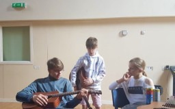 Musical Routes project - Kye teaching Reagan guitar