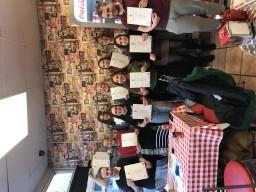 Standing Upright celebrating their Arts Award Success