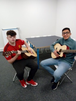 Two care experienced young people learn guitar thanks to youth music funding